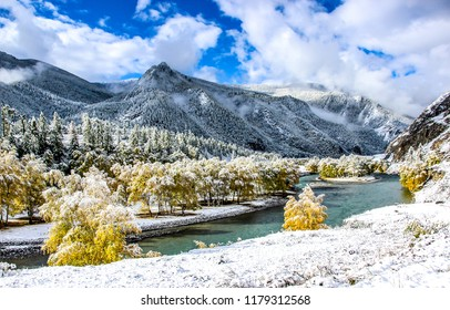 Winter snow mountain river valley landscape. Winter snow river in winter snow mountain valley. Winter snow river in mountains