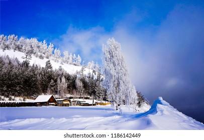 Winter snow mountain village landscape. Winter mountain village view. Mountain village in winter snow landscape. Winter snow mountain village view