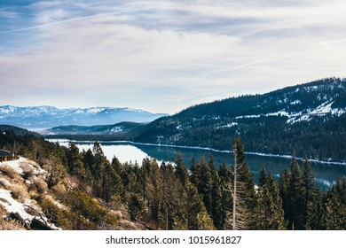 Winter Snow Mountains Forest and Lake  Reflections