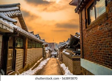 winter snow on rooftop at bukchon hanok village seoul tower south korea