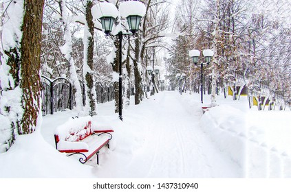 Winter snow park bench view. Winter park bench. Snowy winter park bench scene. Winter park bench landscape