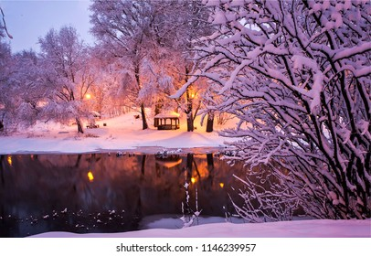 Winter snow park river night landscape. Winter night river in snow city park panorama. Winter snow night park river view