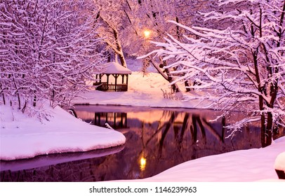 Winter snow park river reflection in night landscape. Night winter park river snow panorama. Winter night river snow view