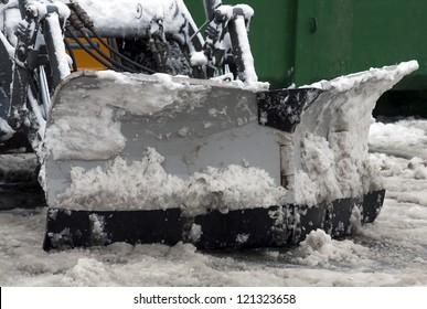 Winter snow removal tractor on the street