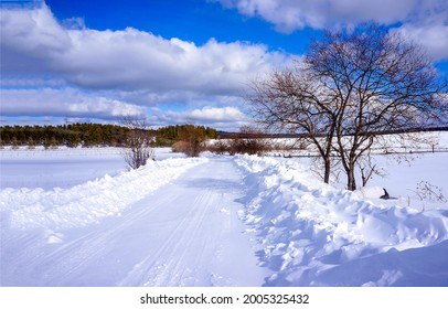 Winter snow road in the countryside. Road in wintertime. Winter snow road. Rural winter snow road