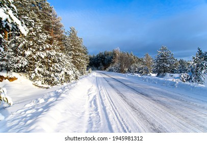 Winter snow rural road landscape. Road in winter forest snow.. Winter snow road view