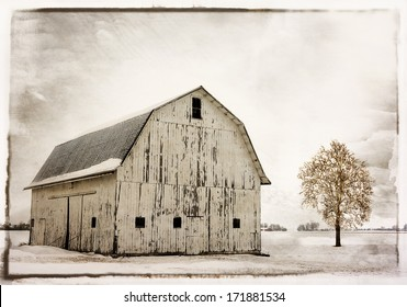 Winter snow scene with an old historic Ohio barn covered with snow.