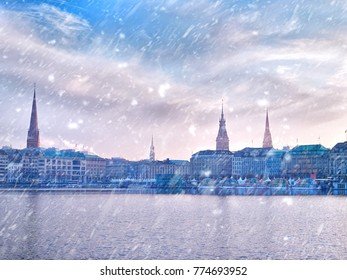 Winter snow town. Alster Lake and winter Hamburg cityscape