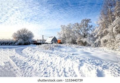 Winter snow village road landscape. Russian winter snow village road view. Winter snor village road in Russia