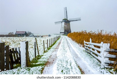 Winter snow windmill farm road landscape. Windmill winter snow road view. Windmill winter snow farm fence road scene