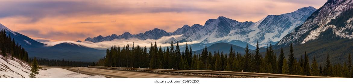 Winter snowstorm rolling through mountain range, Kananaskis Country Alberta Canada
