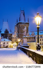 winter snowy Charles bridge, gothic Lesser Town bridge tower, Lesser town district, Prague (UNESCO), Czech republic, Europe
