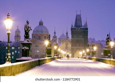 winter snowy Charles bridge, gothic Old Town bridge tower,Old town district, Prague (UNESCO), Czech republic, Europe