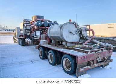 Winter snowy day, heavy truck with equipment for oil production
