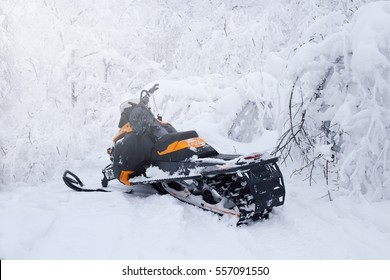 Winter snowy lanscape with road and snowmobile