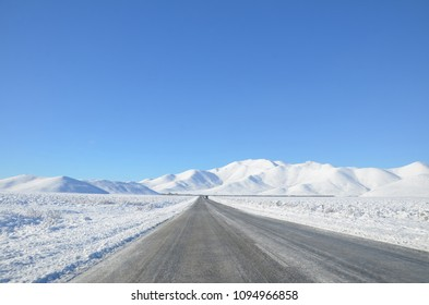 The winter snowy road from Lake Tekapo to Christchurch.You'll pass through several towns and along farmland, and as you get closer to Tekapo, the scenery will start to become mountainous.