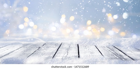 Winter snowy stage background with wooden flooring and Christmas lights on blue background, banner format, copy space. - Shutterstock ID 1471512689