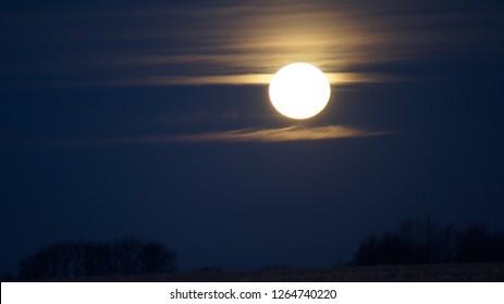 Winter Solstice Full Moon Setting At Sunrise ( Cold Moon) Cornfeild