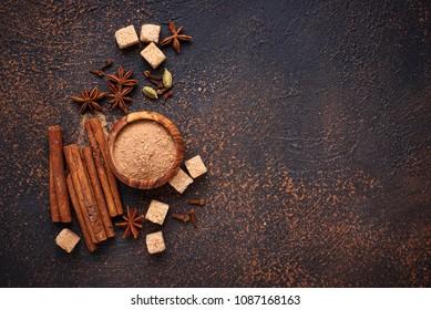 Winter spices cinnamon, anise, cardamom, clover and sugar