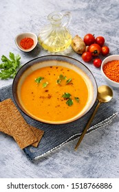 Winter spicy lentil cream soup on light blue background