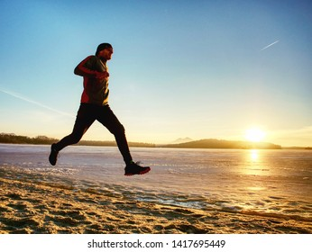 Winter sport lesson. Fitness active people training run outside running in cold weather clothes jogging in landscape. Couple
