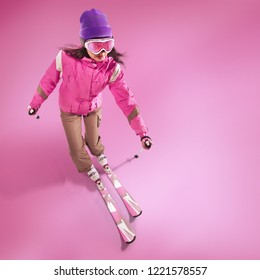 Winter Sport. Skier isolated on pink.
