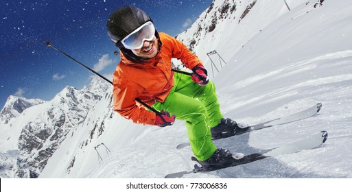 Winter Sport. Skier in mountains.