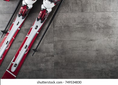 Winter sport theme. Ski equipment on gray tiles. Place for typography. Top view.