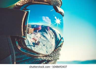 Winter sports concept - male snowboarder in snowboard mask at the top of a mountain - outdoors shot