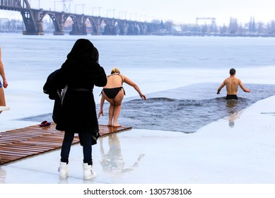 Winter sports, Hardening. People swimming in the river holes.  Orthodox holiday of Epiphany, Dnipro city, Dnepropetrovsk, Ukraine,