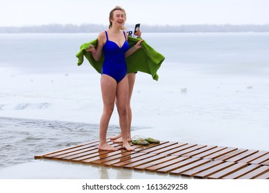 Winter sports, hardening. Women stand in the winter near the ice hole on the Dnieper River during the Orthodox holiday Epiphany. Dnipro city, Dnepropetrovsk, Ukraine,19.01 2019.