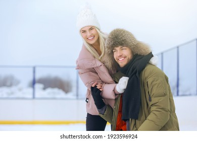 Winter Sports and Lifestyle. Young Caucasian Couple in Winter With Ice Skates Posing Together Over a Snowy Winter Landscape Outdoor. Horizontal image Composition - Shutterstock ID 1923596924