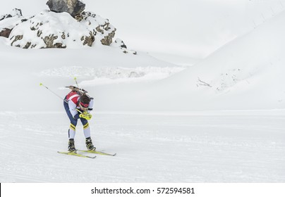 Winter sports: A participant in a biathlon competition in northern Spain