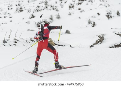 Winter Sports: A participant in a biathlon event in Spain.