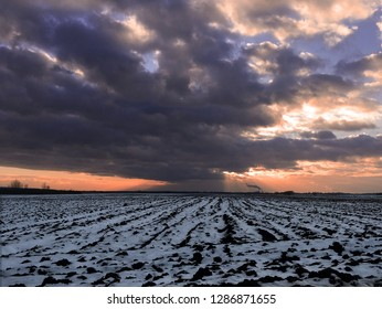 Winter in the Srem Plain. A storm in a field covered with snow.