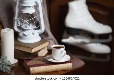 Winter still life with skates, a kerosene lamp, books and a morning cup of coffee. Moscow, December