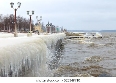 Winter storm on the lake and city embankment covered with ice. Onegalake, Petrozavodsk, Russia
