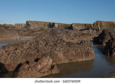 Winter Sun Bathing the Rocks and Cliffs on Summerleaze Beach in the Seaside Town of Bude on the North Coast of Cornwall, England, UK