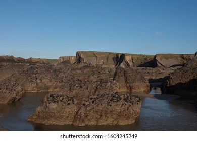 Winter Sun Bathing the Rocks and Cliffs on Summerleaze Beach in the Seaside Town of Bude on the North Coast of Cornwall