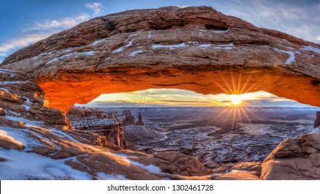 The winter sun rises on a cold January morning at Mesa Arch in Canyonlands National Park, Utah. (panorama)