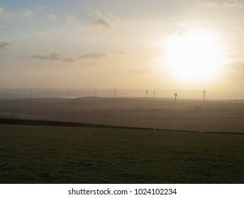 Winter Sun Setting Over Fullabrook Wind Farm in Rural Devon, England, UK