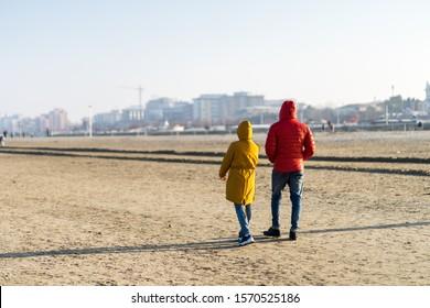 A winter sunday afternoon: walking on Rimini beach.