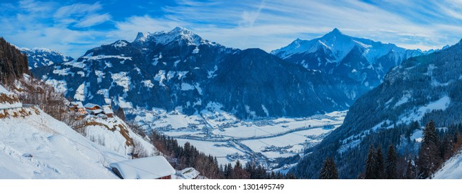 Winter sunny panorama of Austrian Alps with ski huts in the Zillertal Tyrol, Austria