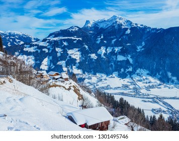 Winter sunny view of Austrian Alps with ski huts in the Zillertal Tyrol, Austria