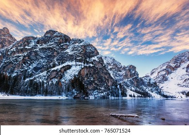 winter sunrise with colorful cloudscape over Lago di Braies, Dolomites, Italy