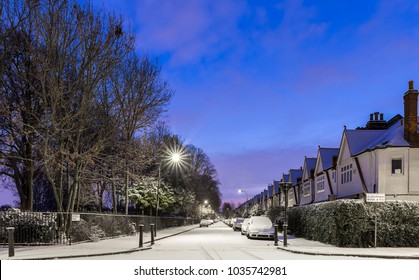 Winter sunrise in snowy suburb in London, UK