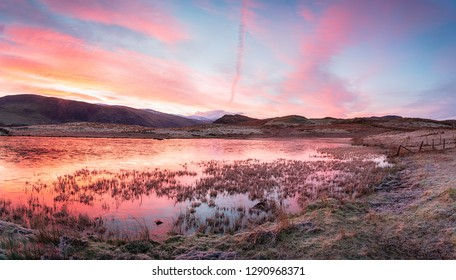 Winter sunrise at Tewet Tarn near Keswick in the Lake District national park in Cumbria