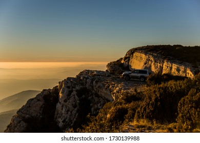 Winter sunset and 4x4 car in Serra Del Montsec, Lleida, Spain