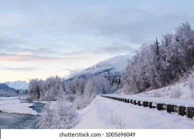 Winter sunset along the Haines Highway with the Klehini river and snow.