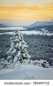 Winter Sunset of the frozen Columbia Lake with the Purcell Mountains, Fairmont Hot Springs, British Columbia, Canada